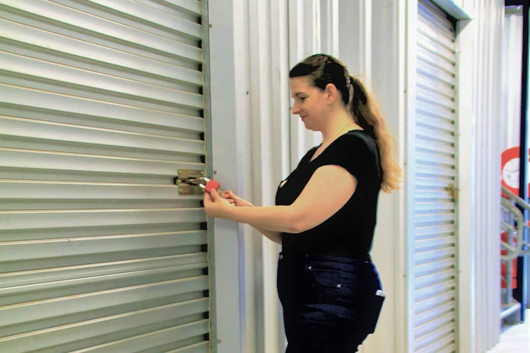 woman locking up storage shed